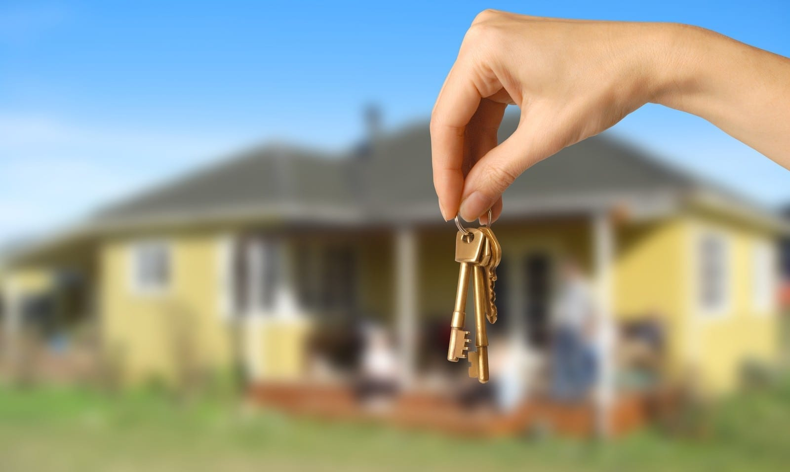 holding key in front of home